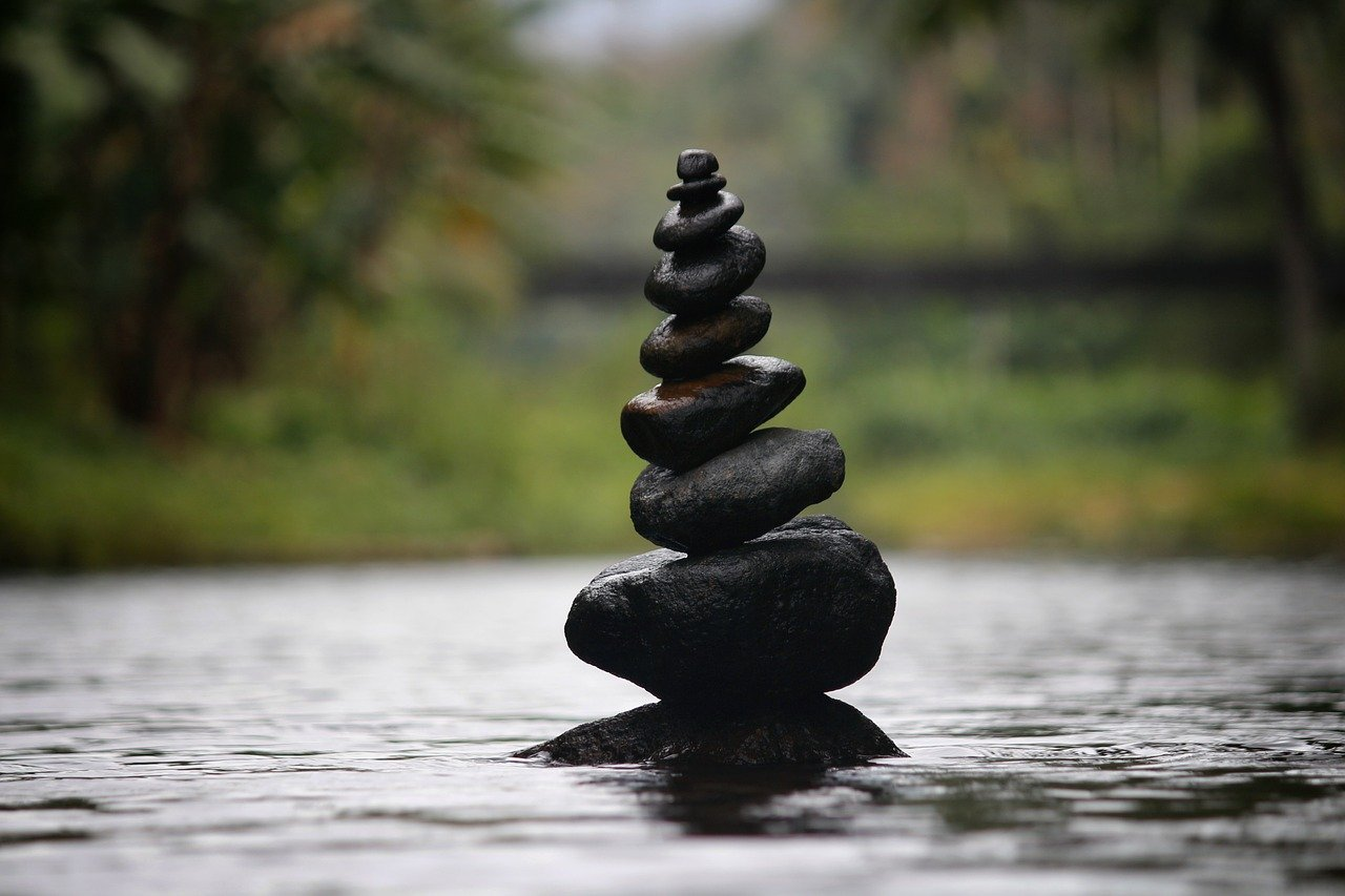 pebbles, balanced pebbles, water